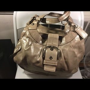 Authentic Coach pewter hobo bag purse.